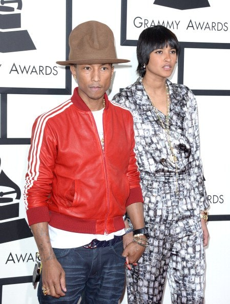 LOS ANGELES, CA - JANUARY 26:  Recording artist Pharrell Williams and Helen Lasichanh attend the 56th GRAMMY Awards at Staples Center on January 26, 2014 in Los Angeles, California.  (Photo by Jason Merritt/Getty Images)